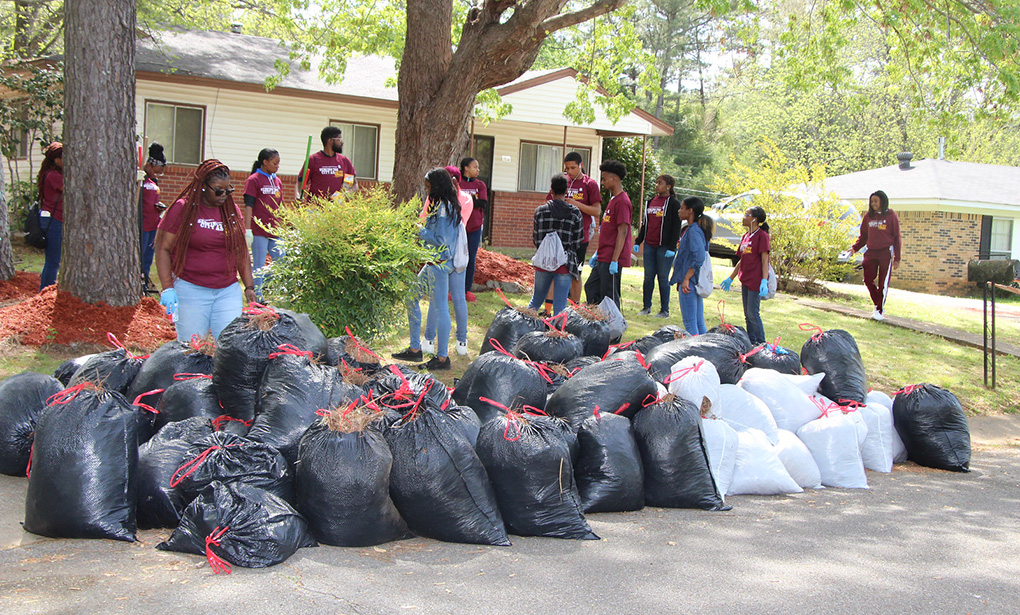 Students cleaning up yard