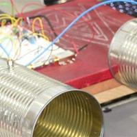 A student project consisting of two tin cans and many wires