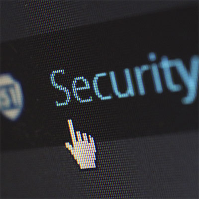 "A mouse-cursor clicks a button labeled ""Security"""