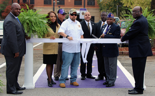 AAMU officials cut the ribbon to one of various types of parking spaces for veterans.