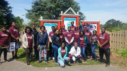 AAMU student volunteers in maroon and white T-shirts