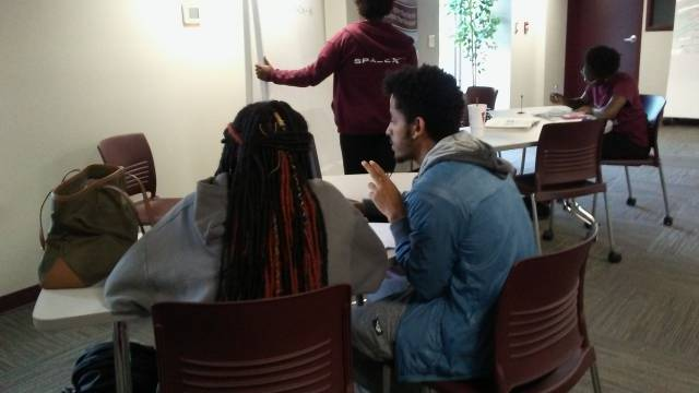 Students receiving tutoring in the TAN Center