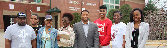 Group photo of CoBPA Dean with Students in front of New School of Business Building