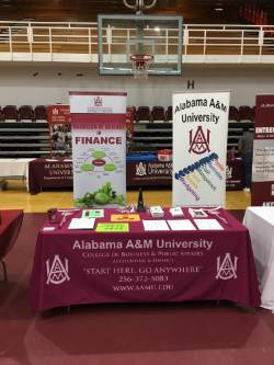 Accounting & Fianance Open House display with bannders behind table