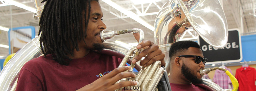 AAMU students play sousaphones at Wal-Mart during Wal-Mart's AAMU Day