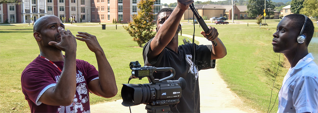 Communications Media students operate a video-camera and boom-mike under the guidance of a Communications Media instructor