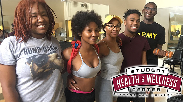 Cover photo for Wellness Center video. Students pose for a photo after a step & strength class.