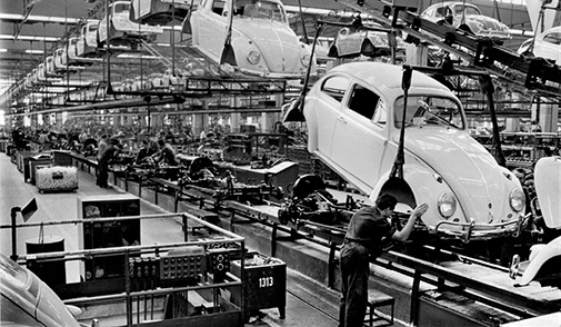 Volkswagen Beetle assembly line with worker