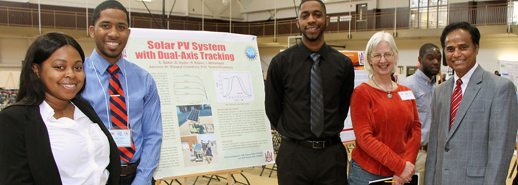 Smiling STEM Day students show off a solar-power research project