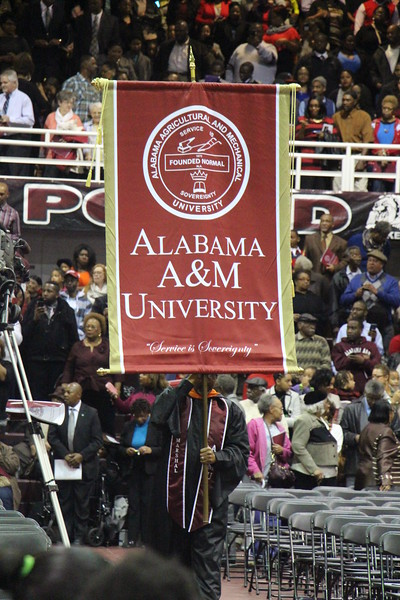 AAMU banner is proudly carried forward during a Commencement ceremony