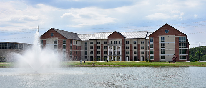 legacy lake in front of new student residence hall