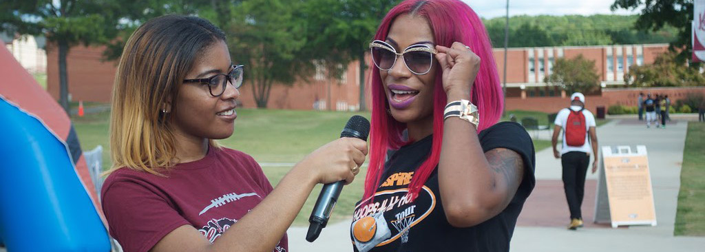 An AAMU student interviews another student at a student event