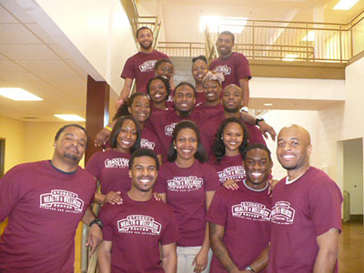 Group photo of Wellness Center employees wearing SHWC T-shirts