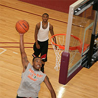An intramural basketball player attempts a lay-up at the Wellness Center basketball gym