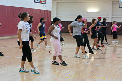 A fitness class exercises in the gymnasium