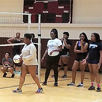 An intramural volleyball game in the Wellness Center's gym