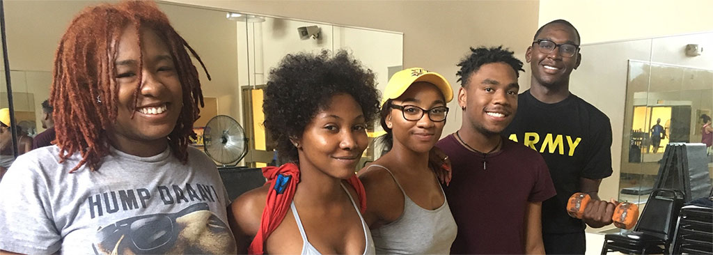 Five smiling students pose for a picture after a fitness class at the Student Health & Wellness Center